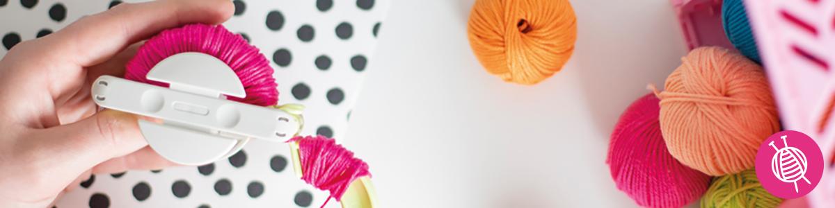 Kleur de wereld met pompons